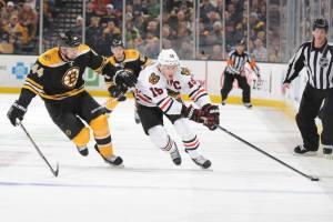 Chicago Blackhawks Jonathan Toews (19) and Boston Bruins Dennis Seidenberg